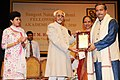 Mohd. Hamid Ansari presenting the Sangeet Natak Akademi Award-2010 to Shri Nityanand Haldipur, Mumbai, for his outstanding contribution to Hindustani Instrumental Music.jpg