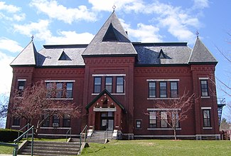 The Gothic Revival Municipal Center (1884) was the High School until 1951