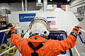 NASA astronaut Serena Aunon enters The Boeing Company's CST-100 spacecraft for a fit check..jpg