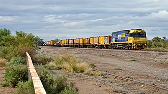 Crystal Brook-Broken Hill railway line - NR110 and a steel train passing through Yunta