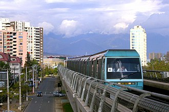 Elevated railway - NS 93 train on an elevated portion of the line 5 of the Santiago Metro.