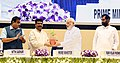 "Narendra Modi being felicitated by the Union Minister for Petroleum & Natural Gas and Skill Development & Entrepreneurship, Shri Dharmendra Pradhan at the inauguration of the ""World Biofuel Day 2018"" programme, in New Delhi.JPG"