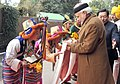 Narendra Modi being given a traditional welcome on his arrival, in Gangtok. The Governor of Sikkim, Shri Shriniwas Dadasaheb Patil and the Chief Minister of Sikkim, Shri Pawan Kumar Chamling are also seen.jpg