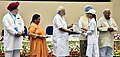 Narendra Modi giving away awards to the winners of national essay, painting and film competitions (2).jpg
