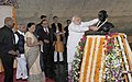 Narendra Modi paying floral tributes to the statue of Mahatma Gandhi, at Mahatma Temple, in Gandhinagar on January 08, 2015. The Chief Minister of Gujarat, Smt. Anandiben Patel and other dignitaries are also seen.jpg