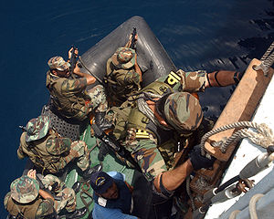 Special Service Group (Navy) - Visit Board Search and Seizure (VBSS) Team Lieutenant Khalid, from Pakistan Naval Ship (PNS) Tariq (DDG 181) prepares to board a CRRC (Combat Rubber Raiding Craft) during a drill in the Gulf of Oman.