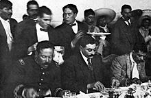 Francisco Villa (left), Eulalio Gutierrez (center), and Emiliano Zapata (right) at the Mexican National Palace (1914). Pancho Villa, el presidente provisional Eulalio Gutierrez y Emiliano Zapata.jpg