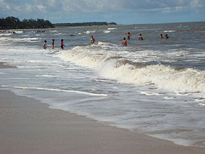 Kihim - Tourists enjoying in the waves on a sunny day on Kihim Beach