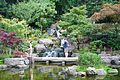 People on bridge in Kyoto Gardens in Holland Park London.jpg