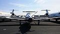 Pilatus PC 12 next to a pair of CHALLENGER 600 Jets photo D Ramey Logan.jpg