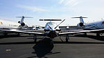 Pilatus PC 12 next to a pair of CHALLENGER 600 Jets photo D Ramey Logan.jpg