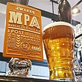 Pint of Manchester Pale Ale next to pump clip.jpg