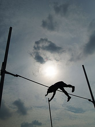 Pole vault - An athlete passes the bar with the aid of a pole