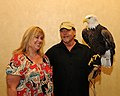 Posing for picture with Bald Eagle. (10596525413).jpg