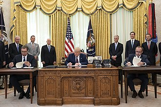 Prime Minister of Kosovo Avdullah Hoti participated in a signing ceremony with U.S. President Donald J. Trump and President of Serbia Aleksandar Vucic on 4 September 2020 in the Oval Office of the White House. President Trump Participates in a Signing Ceremony (50305615147).jpg