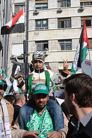 Child on father's shoulders during a Pro-Hamas...