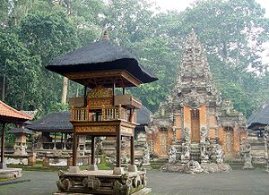 Balinese temple - Richly adorned kori agung gate and pavilions within Pura Dalem Agung Padantegal compounds in Bali.