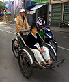 Quy Nhon Cyclo Driver and Woman Passenger.jpg