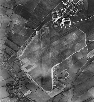 AAC Middle Wallop - Aerial photograph of RAF Middle Wallop looking north, the control tower is in front of the technical site with five C-Type hangars upper right, 29 October 1946