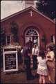 RESIDENTS OF HELEN, GEORGIA, NEAR ROBERTSTOWN, TAKE TIME OUT TO CHAT AFTER SUNDAY MORNING SERVICES AT THE... - NARA - 557666.tif