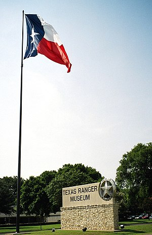 Texas Ranger Hall of Fame and Museum - Texas flag and entrance sign.