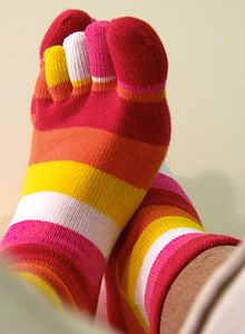 http://upload.wikimedia.org/wikipedia/commons/thumb/1/11/Red_Pink_Orange_rainbow_toesocks.jpg/220px-Red_Pink_Orange_rainbow_toesocks.jpg