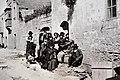 Richard Ellis, A street in Gharb with villagers, ca 1900.jpg