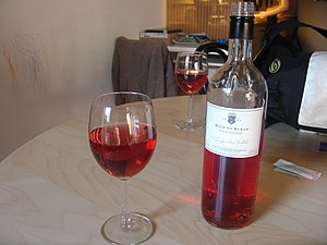 glass & bottle of Syrah rose