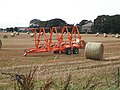 Round straw bales and bale collector, West Scryne - geograph.org.uk - 1659376.jpg