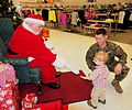 SSGT Battiste, son and Santa 131223-A-ZZ111-002.jpg