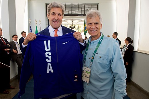 Secretary Kerry and Olympic gold medalist Mark Spitz pose with a Team USA jersey in Rio de Janeiro (28787762565).jpg