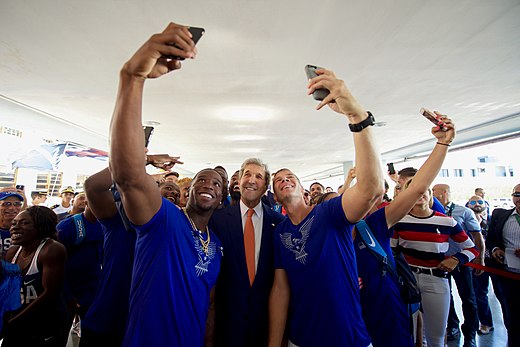 Secretary Kerry poses for selfies with members of Team USA in Rio de Janeiro (28169861744).jpg