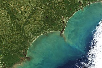 Colored dissolved organic matter - Variations in the concentration of colored dissolved organic matter can even be seen from space. The dark brown water in the inland waterways contains high concentrations of CDOM. As this dark, CDOM-rich water moves offshore, it mixes with the low CDOM, blue ocean water from offshore.