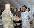 Sgt. Maj. of the U.S. Army Raymond F. Chandler III, left, presents a coin of excellence to Pfc. Britney Willis, with the 1st Brigade Special Troops Battalion, 1st Cavalry Division, at Camp Buehring, Kuwait 120401-A-WD324-004.jpg