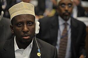 Somali President Sharif Sheikh Ahmed sits in t...