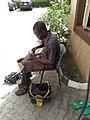 Shoe repairer fixes shoes.jpg