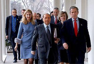 http://upload.wikimedia.org/wikipedia/commons/thumb/1/11/Silvio_Berlusconi_and_George_W._Bush,_walking_along_the_White_House.jpg/320px-Silvio_Berlusconi_and_George_W._Bush,_walking_along_the_White_House.jpg