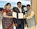 Smriti Irani presenting the Rajat Kamal Award to Swapnil Vasant Kapure (Special Mention) for the Non-Feature film – BHAR DUPARI, at the 65th National Film Awards Function, in New Delhi.JPG