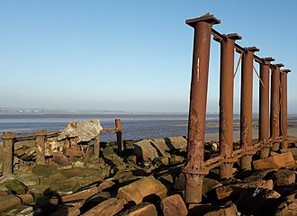 Solway Junction Railway - Remains of Solway viaduct - English side 2018, showing stubs of seaward sections covered in concrete.