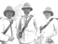 Spanish soldiers wearing 'Rayadillo' uniforms and pith helmets.png
