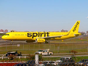 "Spirit Airlines - Spirit Airlines Airbus A321 taxiing into take-off position at LaGuardia Airport in New York City. This plane is painted in the newest ""taxi"" livery, introduced in fall 2014."