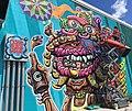 Spraypainting a mural in Hamilton 2017.jpg