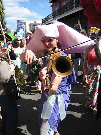 Stroh violin - Man playing a Stroh violin in a New Orleans Mardi Gras parade