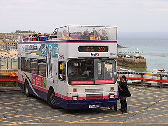 Open top buses in the United Kingdom - Cornwall route 300 bus at St Ives bus station which overlooks the beaches and harbour