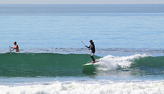 Cardiff-by-the-Sea, Encinitas, California - Stand-Up Paddle surfers at Cardiff Reef in Encinitas, California.