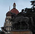 Statue of Chhatrapati Shivaji at the Gateway of India with the Hotel Taj in the background.jpg