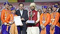 Subhash Ramrao Bhamre presenting the first prize in the best school children items category to the Kendriya Vidyalaya, Pitampura, Delhi for its dance performance 'Tiranga Sakshi Hai' in Republic Day Parade-2017, in New Delhi.jpg