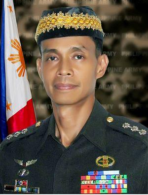 Benito T. de Leon - In army bush coat uniform wearing a Maranao Sultan cap (October 2008)