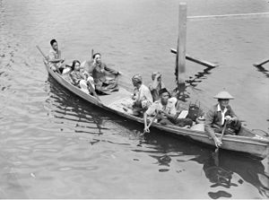 Ahmad Tajuddin - Sultan Ahmad Tajuddin together with his wife and party in perahu after their journey from the village of Tentayer, whence they fled during the bombing of Brunei.