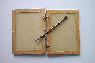 Stylus -  Wax tablet  and a Roman stylus